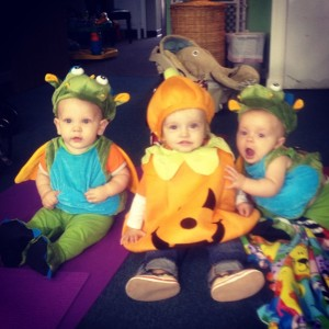 Baby dragons gather around a pumpkin. Bridget is on the right.